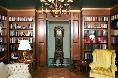 Custom Solid Mahogany English Library by Artisans of the Valley - Shown with Pocket Doors open view into hallway with grandfather clock.