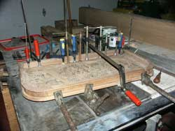 Hand carved bar lid in clamps during restoration