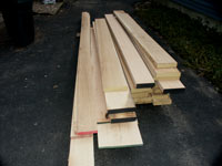 Artisans of the Valley Contract Description - Pile of solid oak lumber