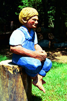Artisans of the Valley feature Chainsaw Carving by Bob Eigenrauch - Fishing Boy sitting on Stump