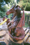 Artisans of the Valley feature Chainsaw Carving by Bob Eigenrauch - Dragon Side Profile Stained Right