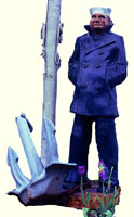 Artisans of the Valley feature Chainsaw Carving by Bob Eigenrauch - Mariner Standing by Flagpole & Anchore