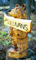 Artisans of the Valley feature Chainsaw Carving by Bob Eigenrauch - Bear with Nametag Sign