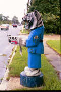Artisans of the Valley feature Chainsaw Carving by Bob Eigenrauch - Tiger in Bathrobe Mailbox Profile