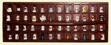 Restored screw tray thimble display rack